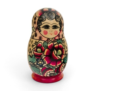 Matrioska, una mu�eca rusa de madera sobre un fondo blanco Foto de archivo - 11924246