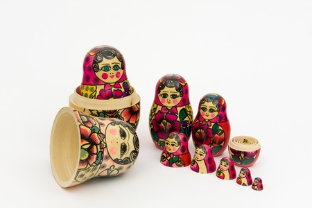 matroshka: Matryoshka, a Russian wooden doll on a white background