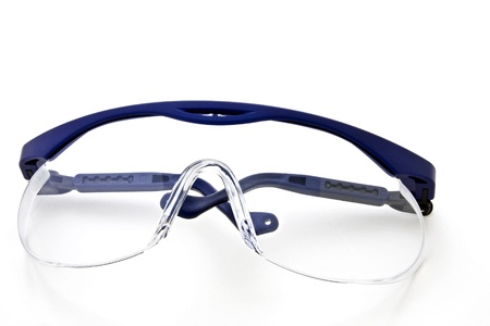 A protective plastic glasses on a white background into. Stock Photo