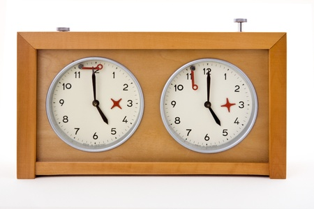 classical mechanics: A classic, mechanical chess clock on a white background into.