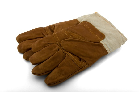 A pair of warm gloves in brown leather for the winter on a white background into. Stock Photo