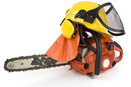 A power saw with a protective helmet with face shield, neck and ear protection on a white background into.
