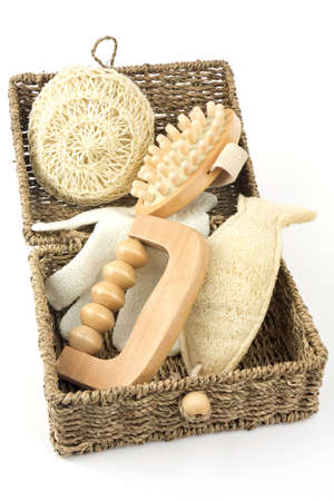 Various items for a massage in a basket on a white background