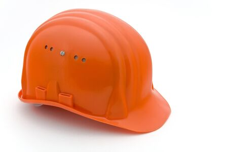 An orange building-site helmet on a white background  Stock Photo