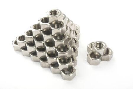 Hex nuts on a white background stacked