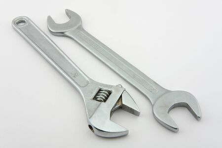 adjustable wrench: A wrench and Adjustable wrench shown on a white background.
