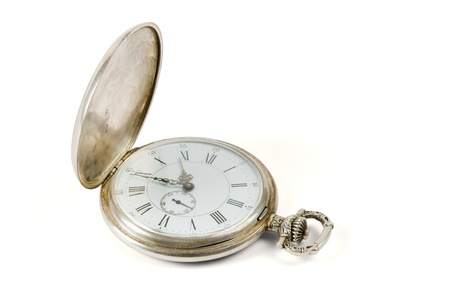 A silver pocket watch on a white background shown.
