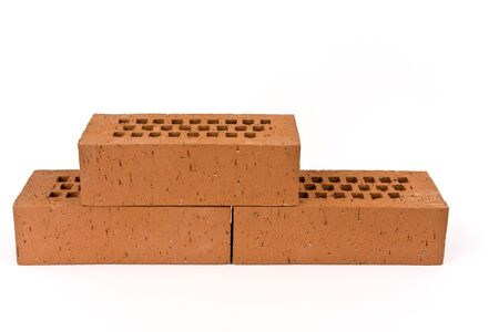 Three bricks on a white background shown.