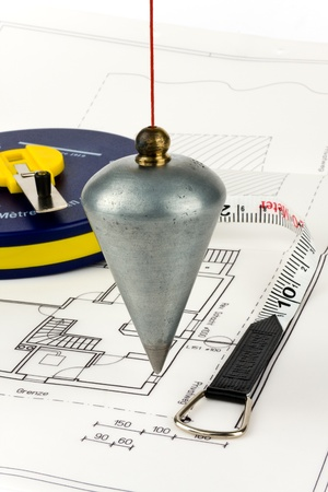 A lot depends on a blueprint on which there is a tape measure. photo