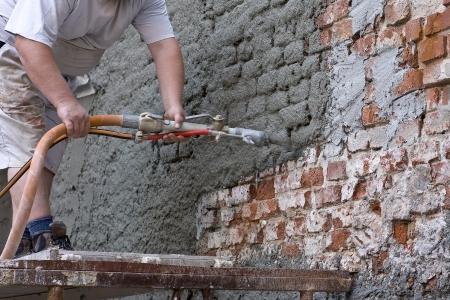 Plasterer plastered an old exterior wall. Standard-Bild
