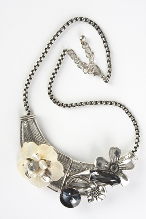 A fashion jewelry necklace pictured on a white background