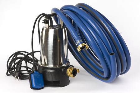 A submersible pump for dirty water and a blue water hose on a white background displayed  Stock Photo