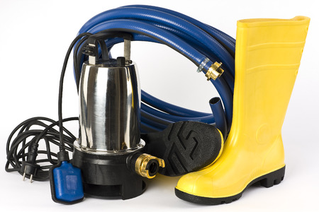 water hose: Submersible pump, rubber boots and water hose pictured on a white background