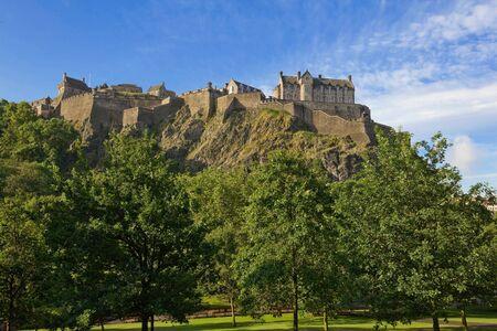 atop: Edinburgh Castle set atop a rocky mountain.