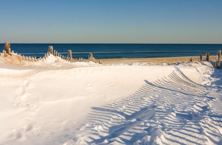 Snow covers part of the beach at the Jersey Shore.