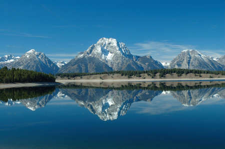 Perfect reflection of Mt Moran in Jackson Lake in Grand Teton National Park, Wyoming