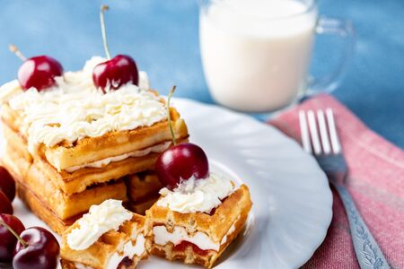 Breakfast, biscuit cake with cherries and milk