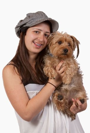 Cute teenage hispanic girl holding a pet yorkshire terrier dog photo