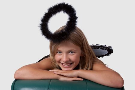 mischievious: Cute little girl in a dress with wings and black halo