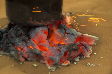 brick kiln: Close-up of burning charcoal with teapot on it Stock Photo