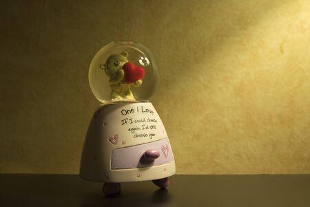 love dome: Snow Globe with teddy bear holding heart inside