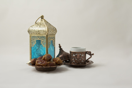Cup of Turkish coffee with Dates and a Copper Lantern