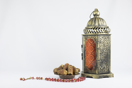 Copper Lantern, Dates fruits and red rosary