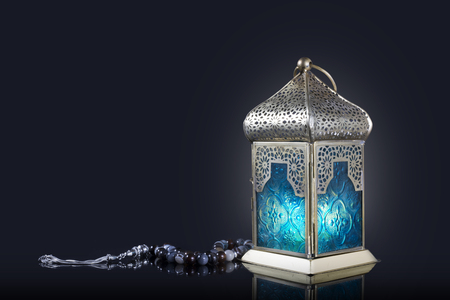 Traditional lantern with rosary beads on a dark background