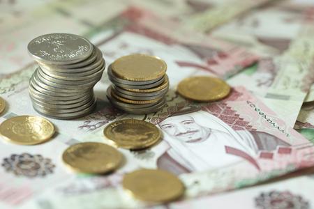 Saudi Riyal notes with Golden pounds