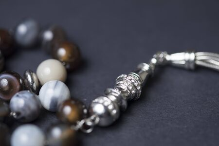 Part of rosary beads on a dark background