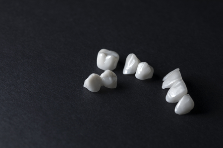 Zircon dentures on a dark background - Ceramic dentures -