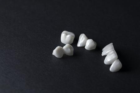 Zircon dentures on a dark background - Ceramic dentures -