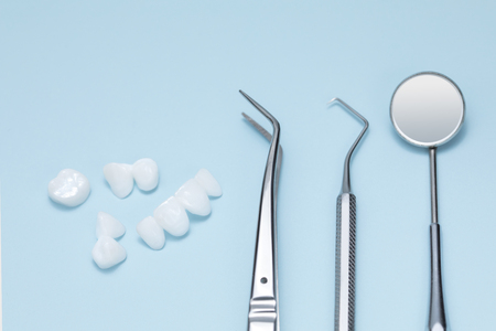 Tooth implant and dental tools on a light blue background Banco de Imagens