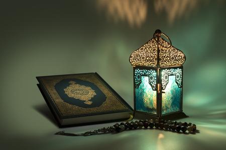 Lantern, Muslims holy book - quran - and rosary
