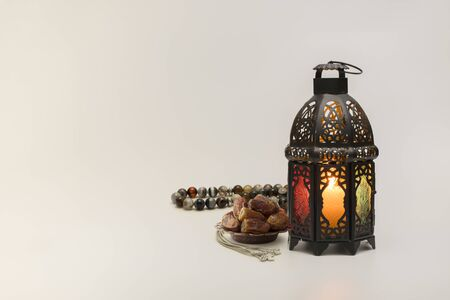 Lantern with Dates fruits and rosary beads.