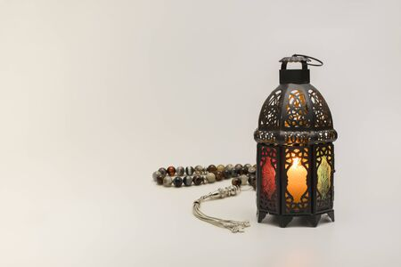 Lantern with rosary beads isolated on white background. Banco de Imagens