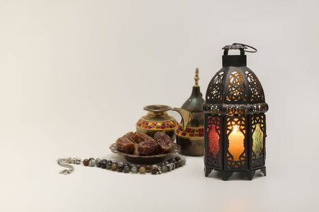 Traditional view of Lantern with coffee pot, date fruits and rosary beads