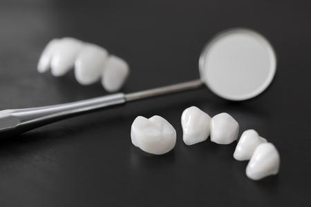 Dental mirror and zircon dentures Ceramic veneers lumineers