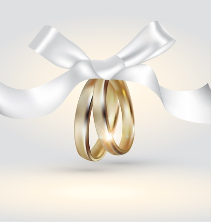 wedding anniversary: Golden  wedding rings with ribbon
