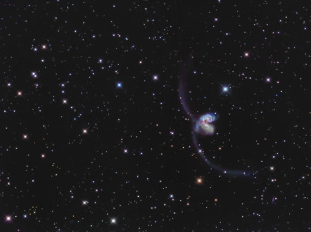 galaxies: Real interacting galaxies called Antennae galaxies or NGC 4038-4039 in the constellation Corvus taken through medium focal length telescope Stock Photo