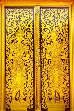 buddhist temple: Thai style painted door Stock Photo
