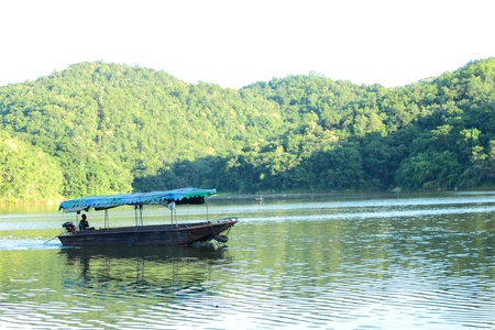 Awning boat in the dam Stock Photo - 9377164
