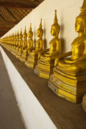 deification: Row of Buddha image under  pavilion at Pra Thart Ing Hung,Lao PDR. Stock Photo