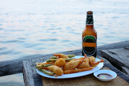 Prawn tempura with cool beer and river background Stock Photo - 10311488