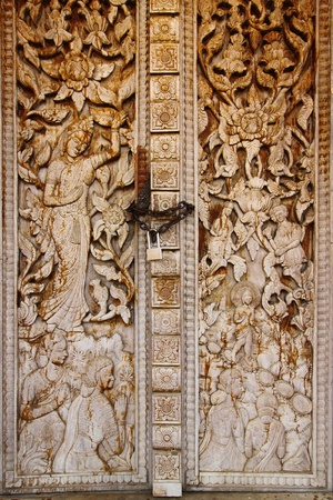 deification: Old door from hard wood of temple in Lao