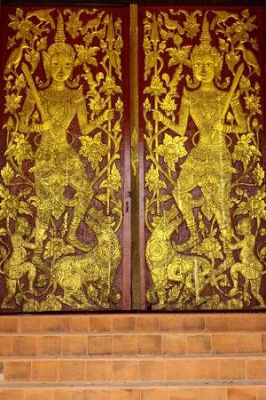 Pattern of door in Thai Buddhism monastery photo