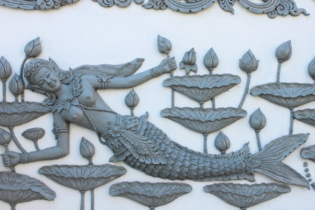 Image of mermaid on wall of Wat Sung Men,Phrae,Thailand photo