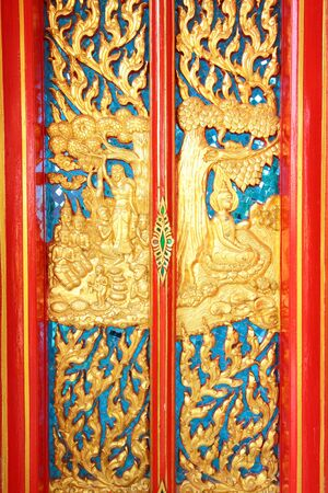 History about Buddhism on door at Pra-thart Pa-nom,Thailand photo
