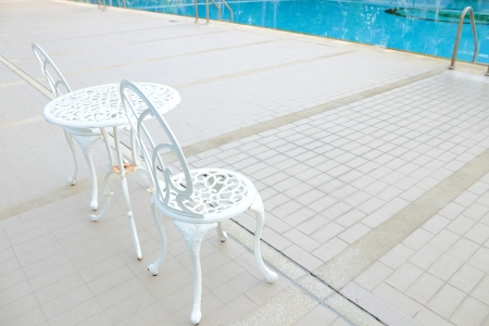 restfulness: Set of table at side pool for relaxing