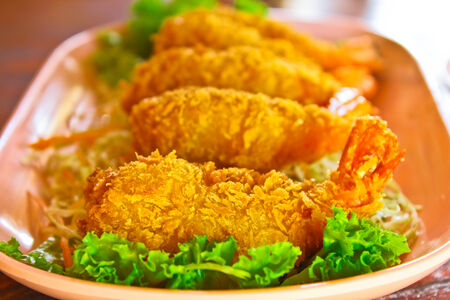 fritter: Prawns fritter cover with crisp bread and salad